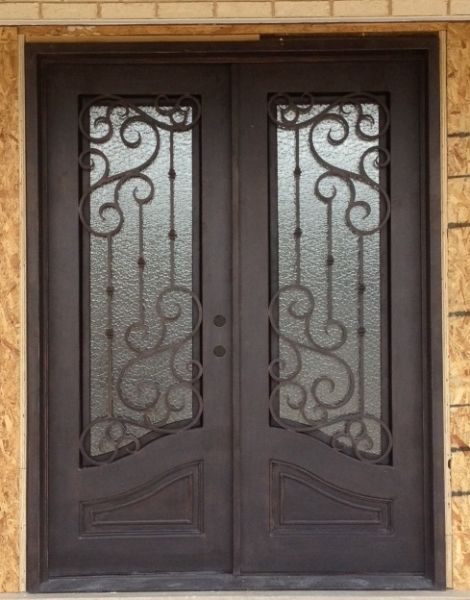 Iron Front Doors Make For Majestic Residential Exteriors